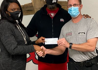 SMFR presenting Sozo's with a $500.00 check